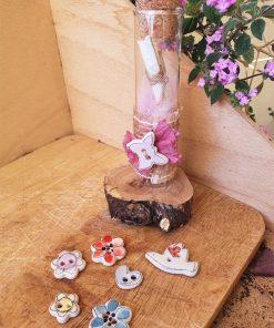 Messaggio in provetta con soggetto in ceramica